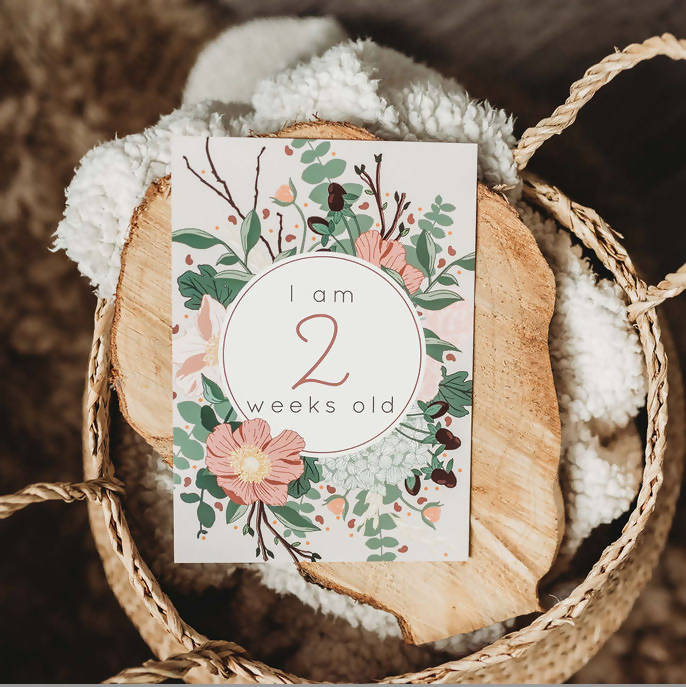 A botanical card to document your baby turning two weeks old
