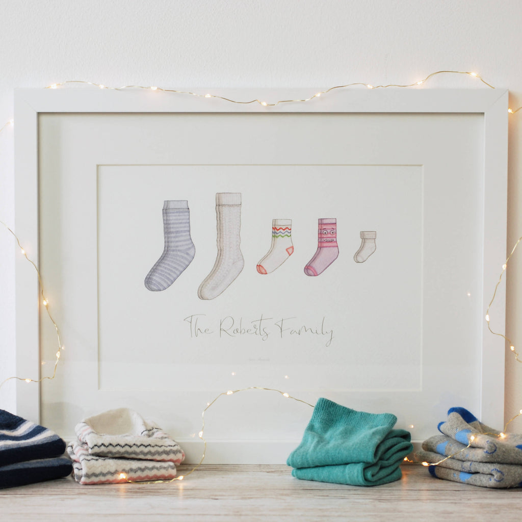 Personalised sock family watercolour art print by Kerri Awosile the perfect Christmas gift wight lights