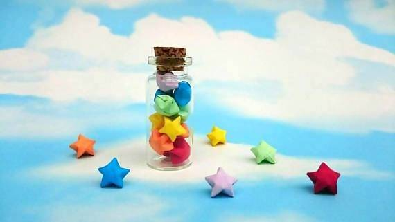 Origami lucky stars in tiny glass bottle
