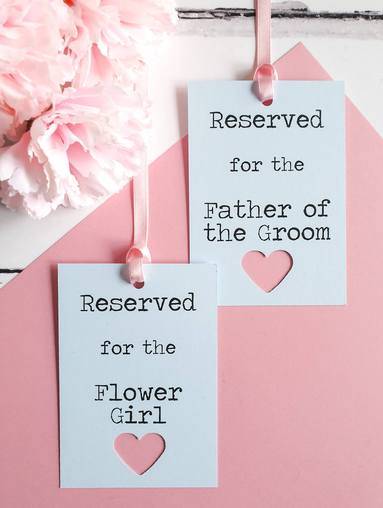 Wedding Reserved Seat Tags in Pale Blue and Pastel Pink. Rustic Heart Detail.