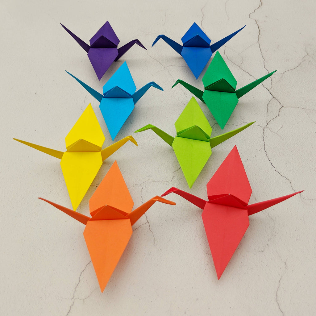 Set of 8 handmade origami paper cranes in rainbow colours