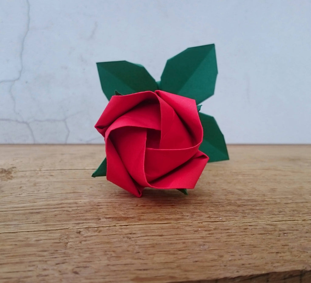 Origami paper rose with leaves in red, pink, ivory, purple, yellow, orange and blue