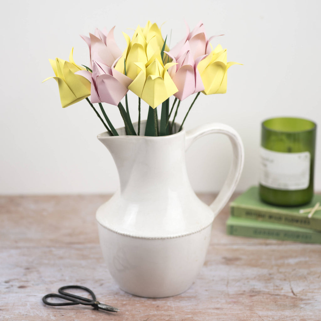 pink and yellow origami tulips in jug