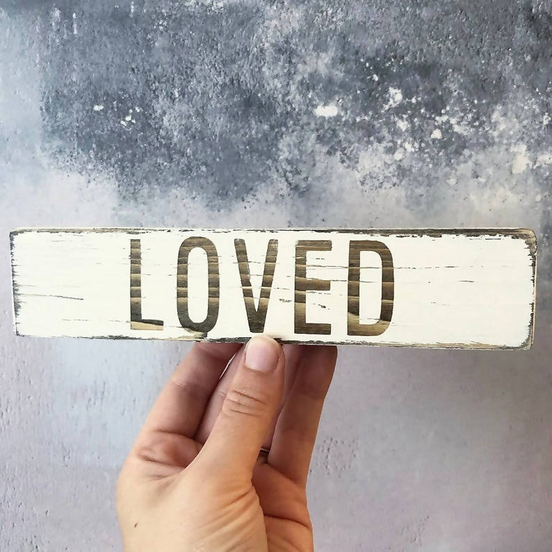 Loved, distressed wooden sign