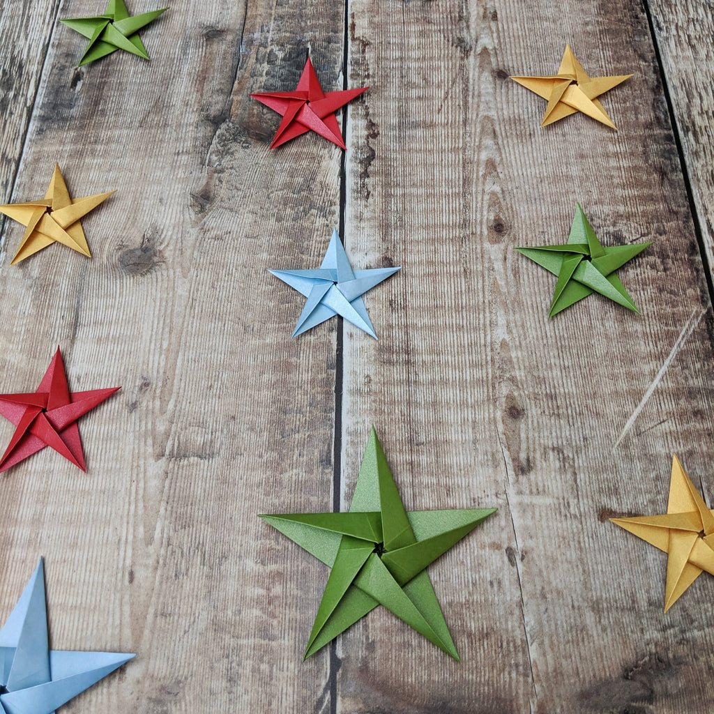 green blue red and gold origami paper stars