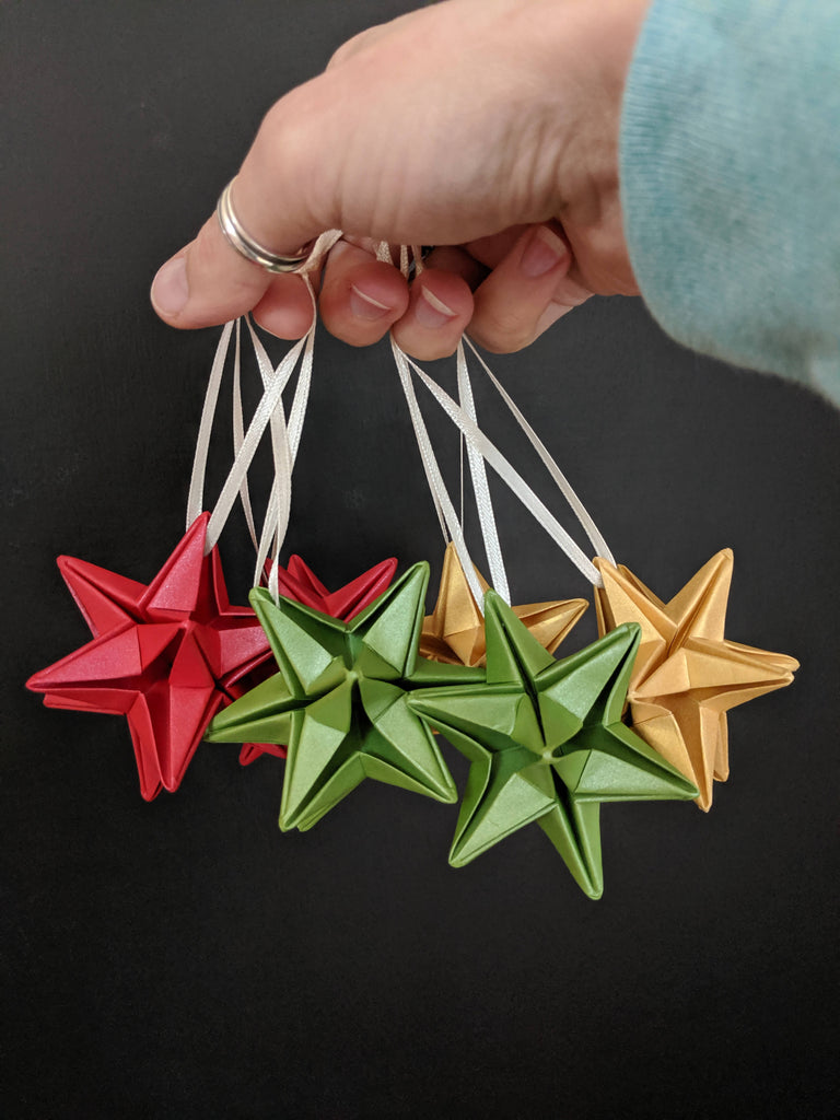 origami star baubles in red green and gold