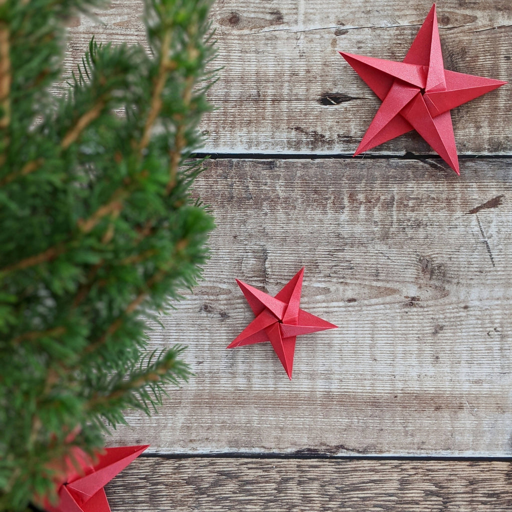 red paper star garland with Christmas tree