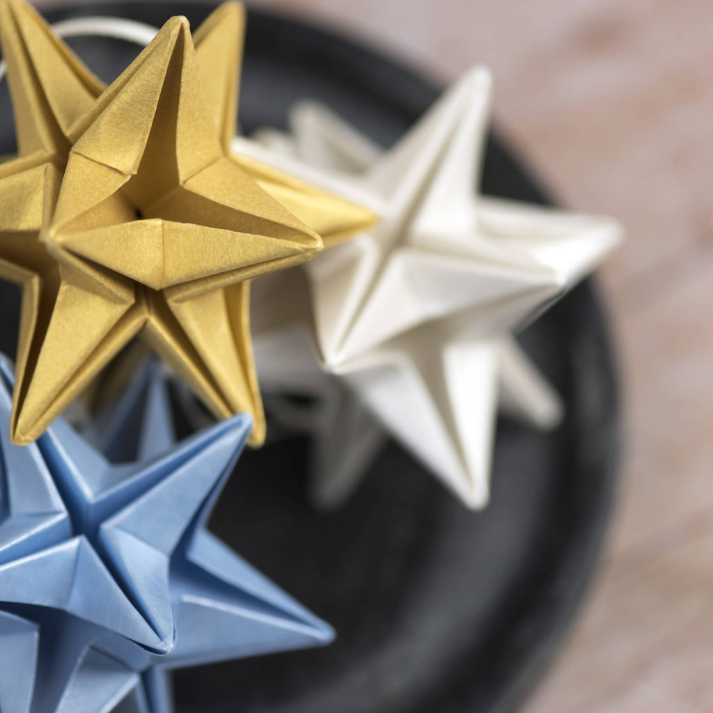 group of three paper star baubles