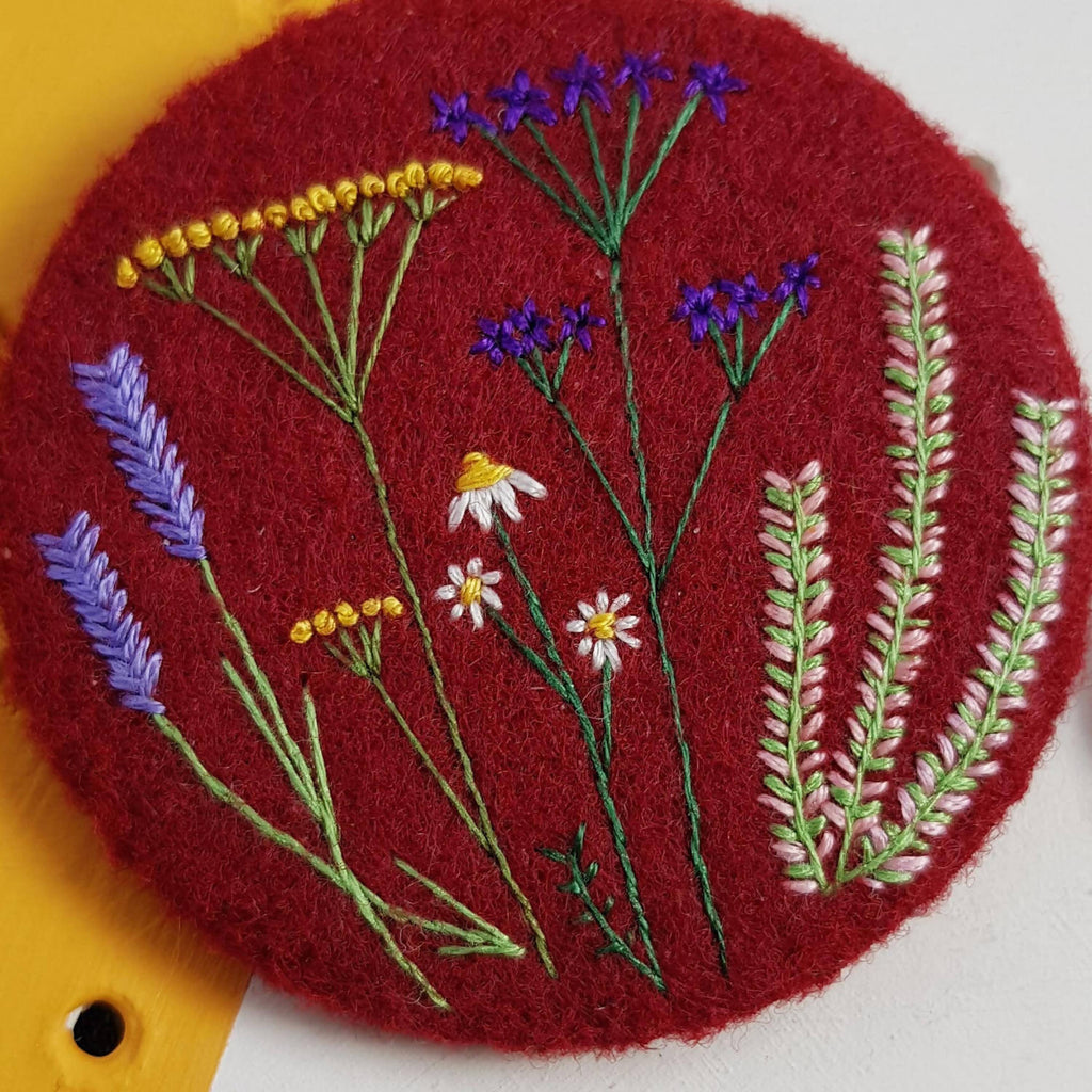 Burgundy wild floral badge