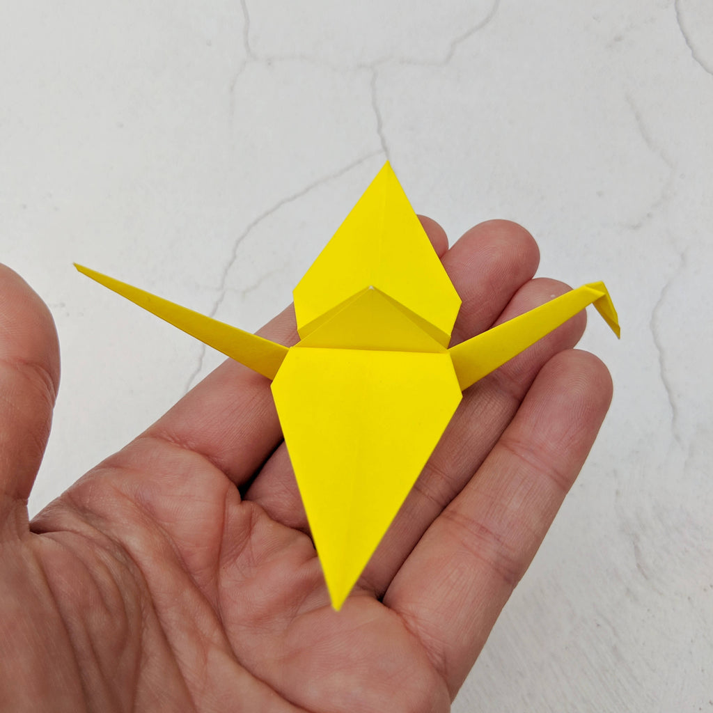 Set of 8 handmade origami cranes in rainbow colours