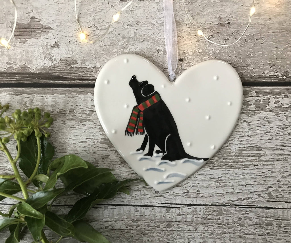 Black Labrador Wearing A Red And Green Striped Scarf Sitting Down In The Snow Hand Painted Christmas Ceramic Heart