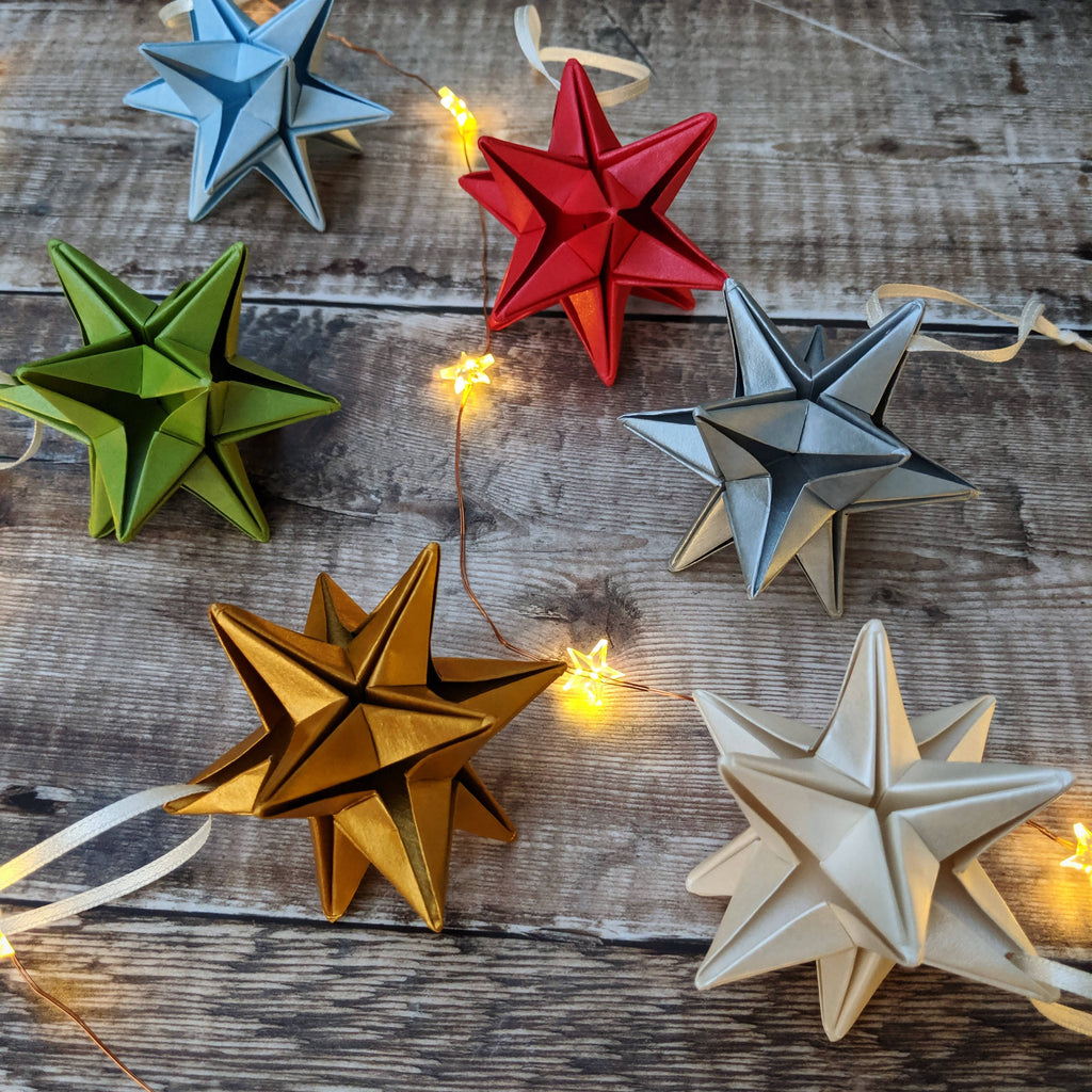 six paper star Christmas ornaments