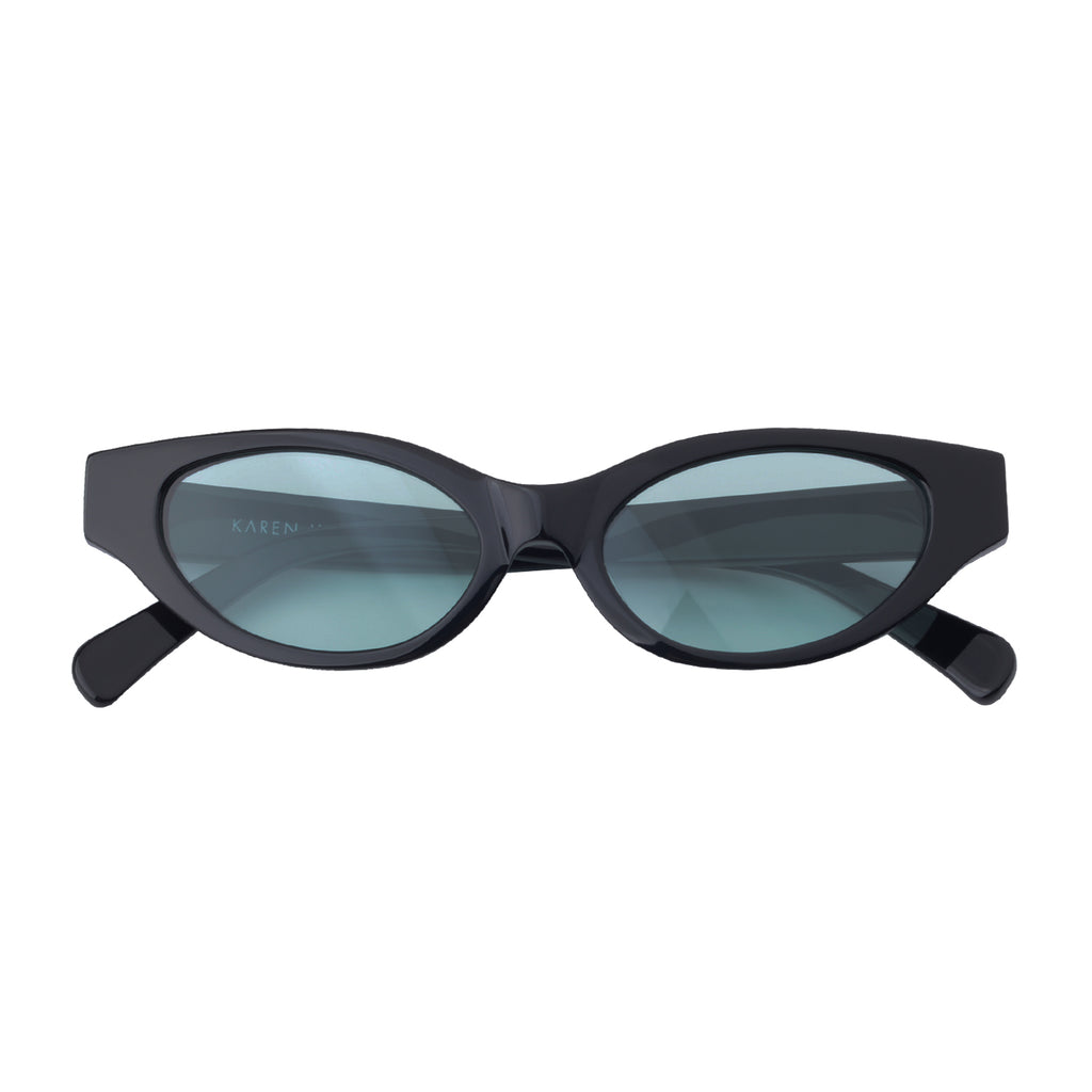 Cat-like sunglasses with cyan blue lenses and black frames | Acetate | Glamorous | Women's sunglasses | Karen Wazen Eyewear