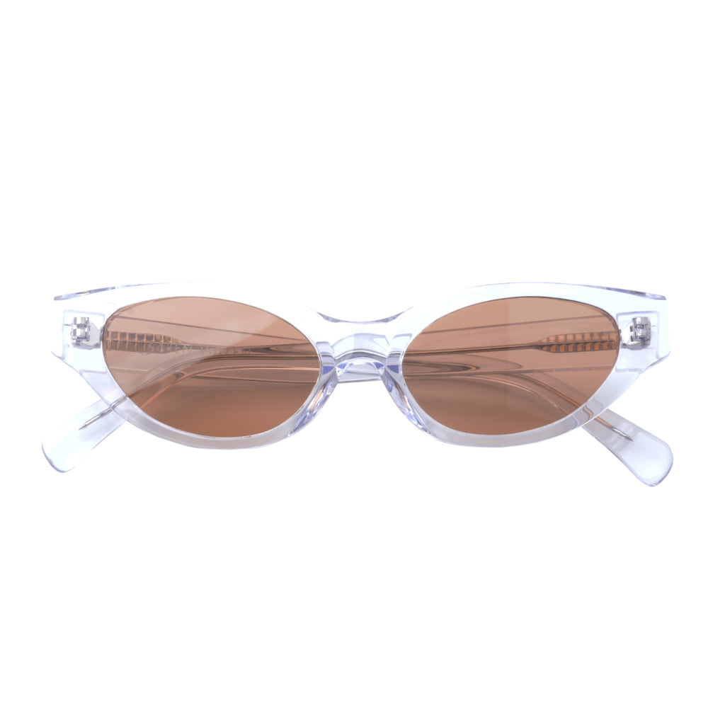 Cat-like sunglasses with brown lenses and clear frames | Acetate | Glamorous | Women's sunglasses | Karen Wazen Eyewear