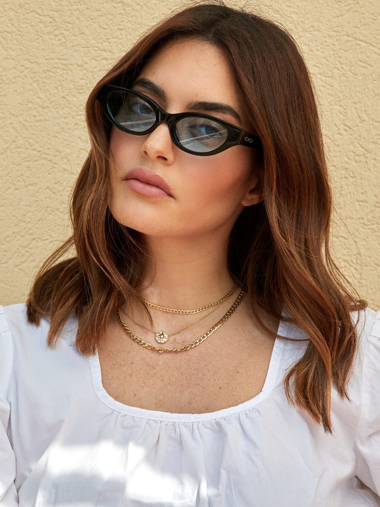 Cat-like sunglasses with blue lenses and black frames | Acetate | Glamorous | Women's sunglasses | Karen Wazen Eyewear