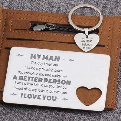Engraved wallet card and heart keychain set on top of a wallet