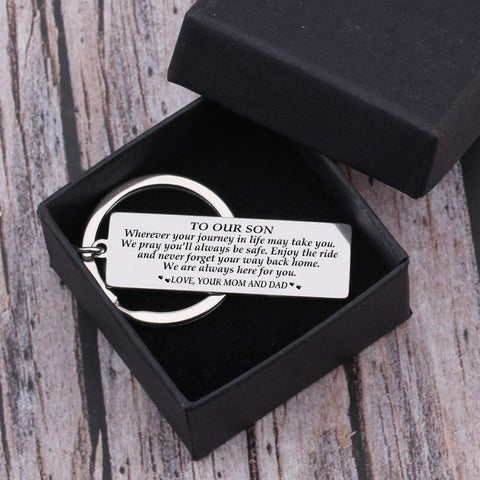 engraved keychain with love message for son from mom and dad in a gift box