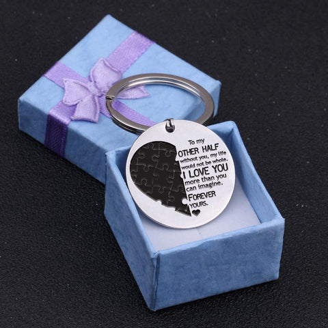 engraved round keychain for loved one in a gift box
