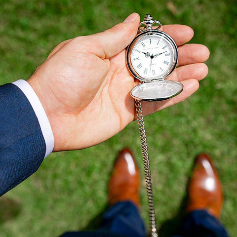 pocket watch on a man's hand