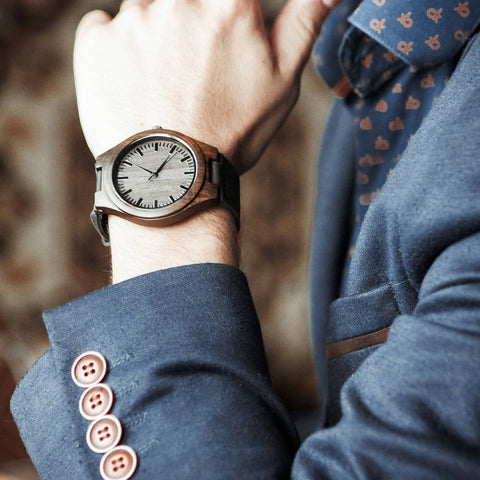 wooden watch on a man wrist