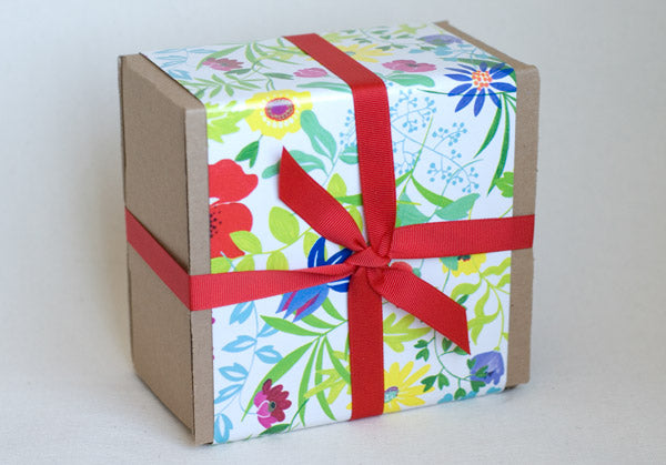 "GIFT: 4 jars, wrapped in ""Flowers"" gift wrap"