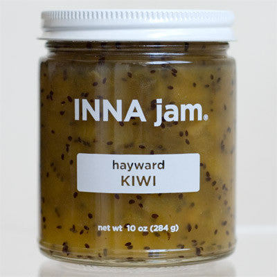 Hayward Kiwi jam! Made from organic hayward kiwis grown in Gridley, California, organic unrefined cane sugar, and fruit pectin. This jam tastes pineapple-y, tropical, citrusy, green-apple-y. It's tart and sweet and crunchy and good! It's especially beautiful, with its black seeds suspended in the bright green jam.