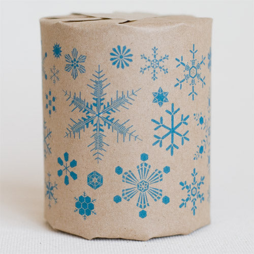 """Snow Flakes"" gift wrap features illustrations of snowflakes (blue print on kraft paper)"