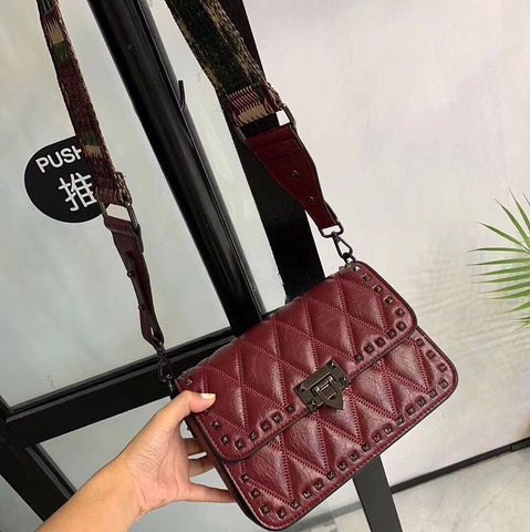 Deep red shoulder bag with interchangeable strap