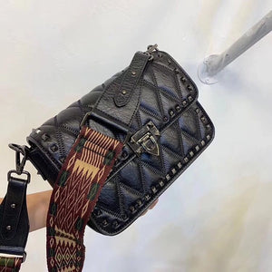 Black shoulder bag with interchangeable strap