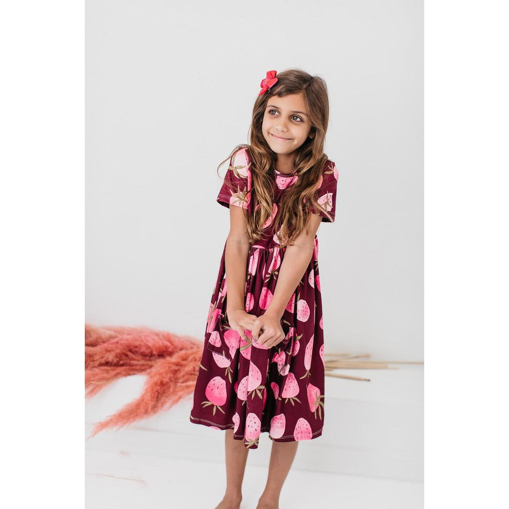 Little Girl in Berry Bliss Mila and Rose Strawberry Print Dress