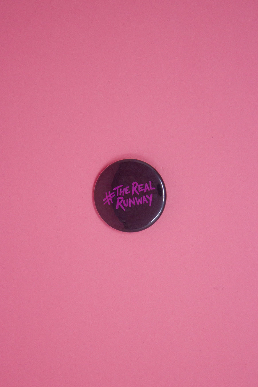 #therealrunway Button