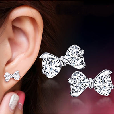 POLISHED FANTASY - SILVER BOW STUD EARRINGS