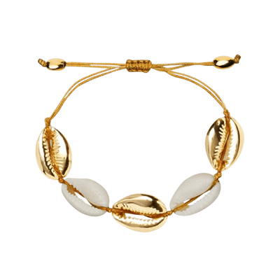 gold plated shell bracelet and earrings on wooden ornament - chuchka australia