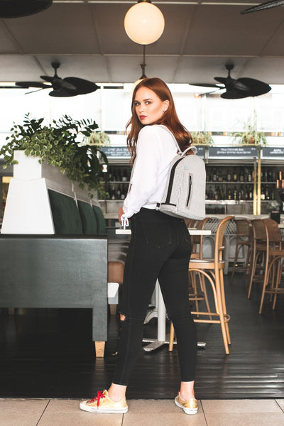 Girl wearing Kimi chuchka neoprene backpack in grey