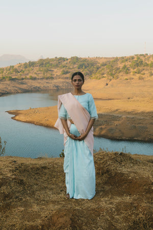 Cloudless sky and nude sari