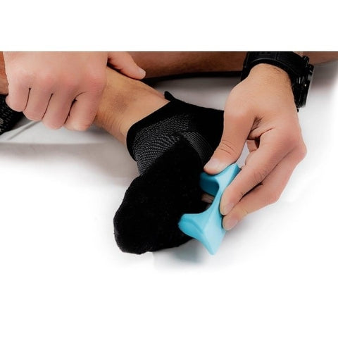 Pro-Mini Muscle Release and Self-Massage Tool being used on bottom of foot