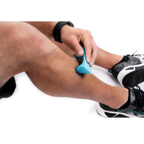 Pro-Mini Muscle Release and Self-Massage Tool being used no shin