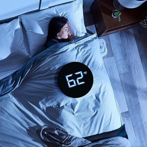 woman sleeping with temp display