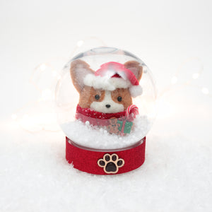 Red Santa Corgi with Gingerbread Man and Candy Cane Snow Globe