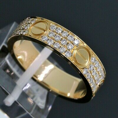 SOLID S925 SILVER WITH LᎾVE CZ RINGS IN GOLD