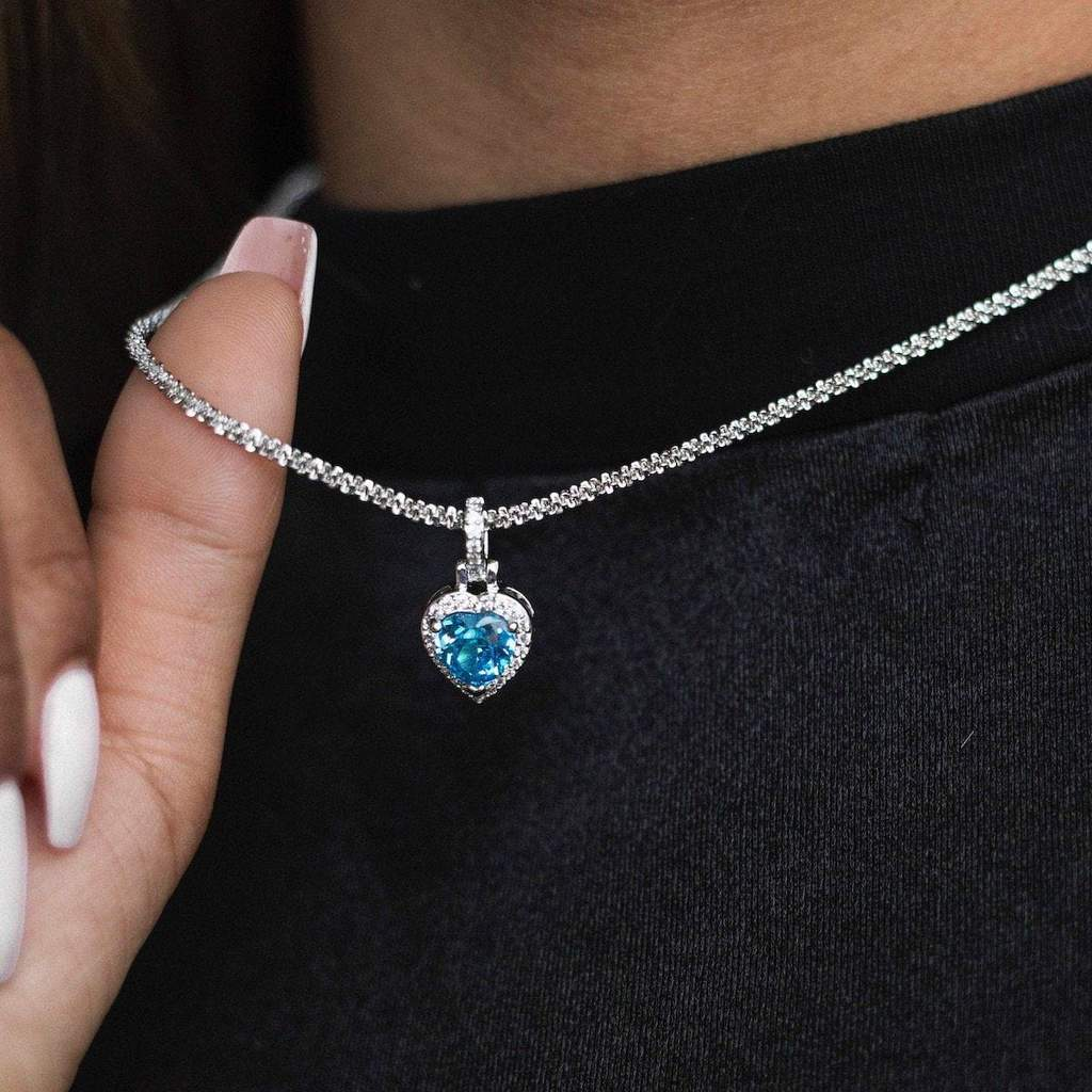 ICED HEART CZ PENDANT IN WHITE GOLD BLUE STONE