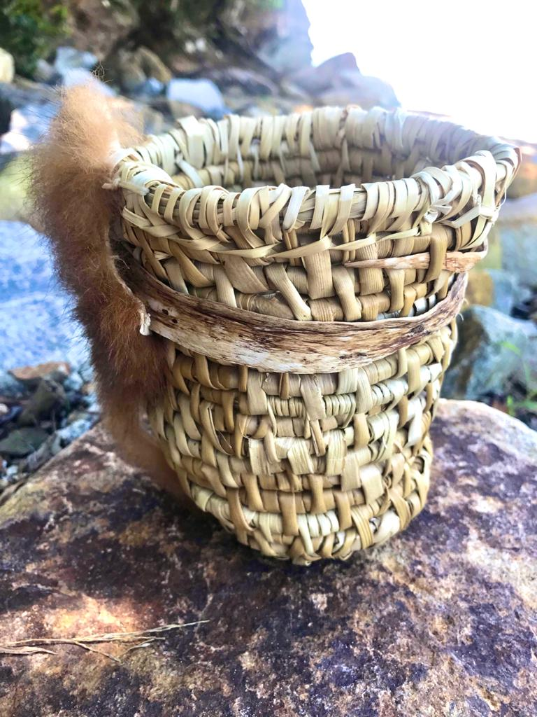 Collecting basket with possum fur