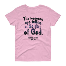 "Load image into Gallery viewer, Ladies light pink tee reads ""The heavens are telling of the glory of God. -Psalm 19:1a"""