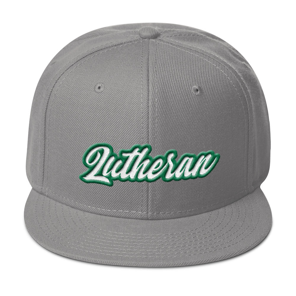 Grey baseball cap with Lutheran in green and white embroidery