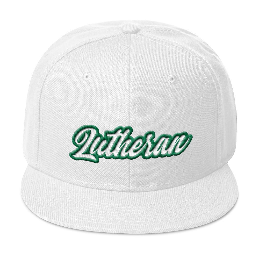 White baseball cap with Lutheran in green and white embroidery