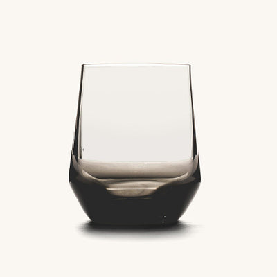 A wine glass with a dark tint in the glass.