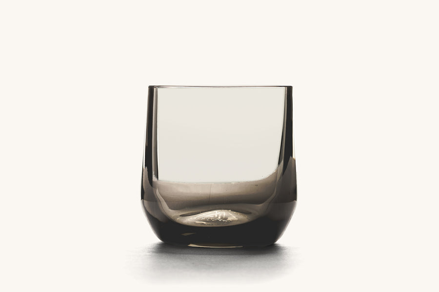 A nice cocktail glass with a dark hue.