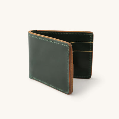A green leather bifold wallet.