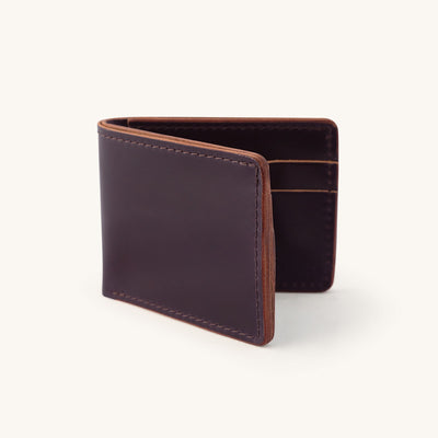 Leather bifold wallet in a dark purple color.