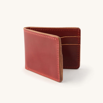 Red leather bifold wallet.
